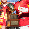 "Calvert Hall players display ""4"" with their fingers after winning their fourth consecutive Turkey Bowl against Loyola Blakefield."