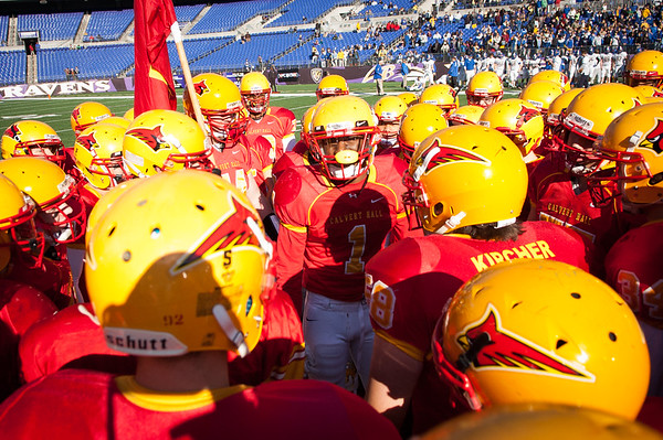 Calvert Hall senior Delando Johnson (1) delivers a pep talk to his Calvert Hall teammates before the kickoff of the 93rd annual Turkey Bowl between Calvert Hall College and Loyola Blakefield.