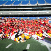 The Calvert Hall Cardinals pose with the Turkey Bowl trophy after winning by a score of 21-14 in the 93rd annual Turkey Bowl. The Cardinals have won the trophy four consecutive years.