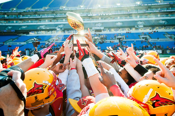 The Calvert Hall Cardinals raise the Turkey Bowl trophy after winning by a score of 21-14 in the 93rd annual Turkey Bowl. The Cardinals have won the trophy four consecutive years.