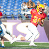 Calvert Hall senior Stephen Kelly (24) breaks free of Loyola Blakefield defenders during the 93rd annual Turkey Bowl.