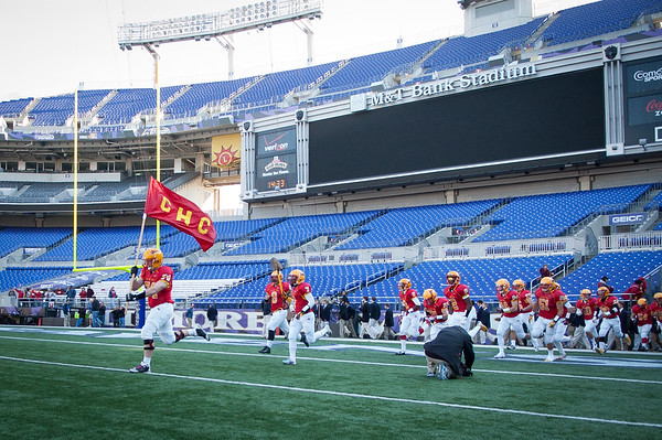 The Calvert Hall Cardinals enter the field for the 93rd annual Turkey Bowl.
