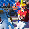 Kyle Levere (9), senior at Calvert Hall, runs through a hole in the defense during the 93rd annual Turkey Bowl.