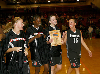 Chronicle photo CURTIS CLEGG DeKalb # Freeport players with plaque