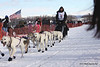 Justin Savidis and dogs leave Willow bound for Nome in Iditarod 2010.