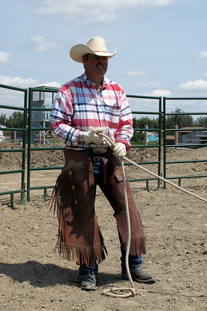 Colton handling the rope on the horse's hind foot