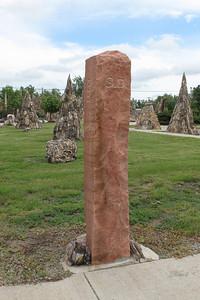 Granite North Dakota / South Dakota Stateline Marker  Petrified Wood Park Lemmon, S.D. June 2009