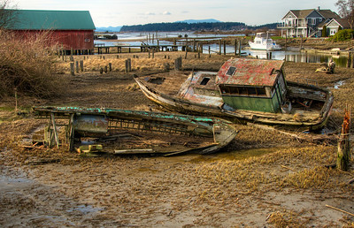 10 Mar 11. With the chance of being boring accepted, we return to the Salish Slough and another HDR photo. Today's image is almost the same as yesterday's, save for a few additional features. And a little more of the story if you will. Directly behind the red building, a former and now defunct cannery, you will find several very run down homes of what are apparently fishing families who have maintained all their occupational equipments and have them strewn just about everywhere around their properties, including signs that let you know in no uncertain terms that these homes are PRIVATE PROPERTY and that you are not welcome. Situated directly across from these properties you find total opulence in 7 figure properties. The two groups of properties each looking across at the other. One can only wonder if the opulence represents ownership of the former cannery and the slum like properties those of the workers. I have absolutely no way of knowing anything about either group, and perhaps even speculating is completely inappropriate, most likely so! But as you look at the total picture you are free to make up your own story. This shot is taken from just a few feet distant from that of yesterday's offering, which I guess just supports that old adage of location, location, location. Puget Sound proper sits near the top of the image where the blue colored mountains peek out at you. ISO 200; 1/160 sec for the middle of the 5 frames that comprise this HDR image @ f /13.