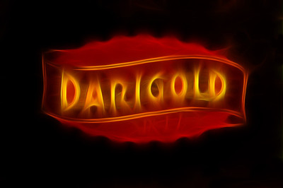 05 Oct 11. Picking up from yesterday, we now look at the Darigold Logo a bit more closely. Of course, what I'm sharing isn't quite the logo as you saw it in yesterday's image. For starters, the logo image I'm sharing today started out as its own close-up, so it hasn't actually been cut out of the cow shot. Then I did a few small adjustments to it that go as follows: after making a copy of the background layer, I selected just the letters and put them on their own layer, then I added a black stroke around the letters, then added a color overlay for a bit of color adjustment, then a bit of bevel & emboss followed by an outer glow and a drop shadow to complete that layer. Then followed a curves layer with mask to keep the curves adjustment limited to selected areas, and then another curves layer for further adjustment of the shadows and highlights. Those four layers were then flattened, a copy of the flattened layer made for removal of the mortar seams, and then a final layer was created for employing a creative filter called glow100. Then all that was flattened once again for the final image. A relatively easy manipulation but it took about an hour to get it just the way I wanted. Now you can go back to yesterday's image and compare the two logos. I like the manipulated one better and am planning on mailing it to Darigold to see how they like how I've adulterated their namesake.  ISO 400; 1/1000 sec @ f / 5.6.