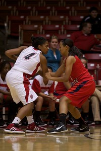 Angel Dorn looks into the eyes of her Dixie State defender before she puts up two points in Monday's game