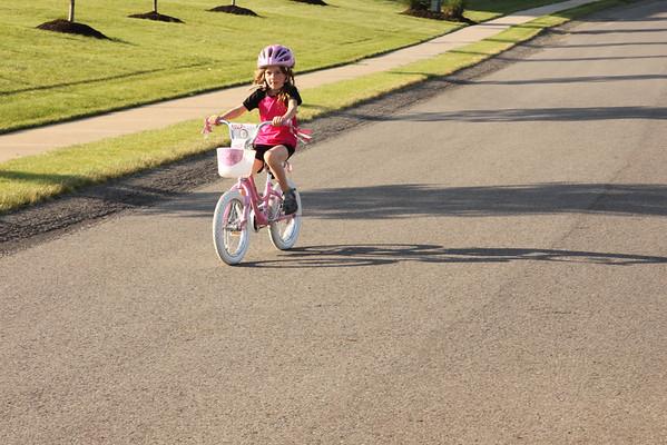 05.20.12 Remi Riding Bike