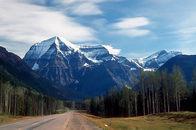 "19 Apr 12.  Traveling along Canada's Yellowhead Highway in 1973, on my way to Edmonton, I passed by one of the most beautiful mountains I had seen anywhere, but was unaware of what I was seeing. When I arrived in Edmonton I was asked if I had seen Mt Robson, the highest peak in the Canadian Rockies. I mumbled something about I didn't know if I had or not, but that I had passed by this beautiful peak along the way. Pressed for a more definitive response, it was determined that I had indeed passed by Mt Robson and, more importantly, gotten a very rare opportunity to actually see it. Further discussion revealed that the mountain is seldom visible and that to see it is comparable to a gift. The folks with whom I was staying had never seen it their entire lives and thought it a good omen that I had. Perhaps so, because my interviews there went very well. Jan flew up a few days later to join me, and we then drove back to Seattle together, passing by the park to see if the mountain might once again be visible, something my friends thought would be akin to winning the lottery, only there weren't any lotteries back then. To bad too, because, lo and behold, the mountain was once again out in all her splendor. We spent a couple hours there seeing the sights to include a sign about not feeding, teasing, encouraging, or anything else with the bears to include leaving exposed food in your vehicle. Apparently the owner(s) of a rather nice convertible didn't fully comprehend what that sign really meant and left some exposed food in their vehicle. Well now, would you believe, a hungry bear (read that as all bears) just happened by and, finding a container with an easy opening lid, took advantage of the situation and, with one swipe of its paw ""removed"" the soft top, climbed in, and had a self serve lunch. Perhaps I should rewrite that sentence describing the vehicle to say a previously nice convertible as it wasn't by the time we saw it. Should have taken a photo of that but didn't, instead concentrating on the block of granite that few people supposedly ever see. It was a good visit and an even better drive as the Yellowhead Highway has to be one of the most beautiful drives anywhere in the world. No stats on the shot for today as it was taken almost 40 years ago with my F2AS and 55mm macro lens on Fujichrome 100 slide film and which I have just recently scanned."