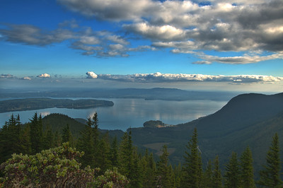 24 Oct 12.  This is another shot taken from the top of Mt Walker while we were sightseeing with friends almost a month ago! It is from a series I shot to create an HDR image but I liked this well enough to use it on its own. In the far distance at the left about 9 o'clock I believe you are looking at Tacoma, and I am at a loss as to the name of the islands in the foreground. It was just prior to 1700 PDT when I took the shot and it was beginning to look like we might get rain. But we managed to avoid such and shot for almost another 30 minutes before calling it quits for the day. The image was O.K. as it was, but it seemed to be lacking a bit of detail in the sky, so I did a little micro contrast increase over the entire image, then masked it out everywhere except for clouds in the upper area of the sky. Otherwise, it is a basic shot straight from the camera. Nikon D300s; Aperture Priority; 18 - 200; ISO 200; 1/60 sec @ f /16 on a tripod.