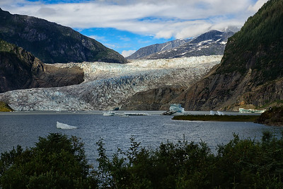26 Sep 12. Arriving in Juneau with lots of blue clouds (sky), we elected to make immediate use of the good weather and do some sight seeing. Our first effort was to take me to see the Mendenhall Glacier, roughly 10 minutes from the airport. This is an easily accessible glacier and hosts a very nice visitors center that presents the science of glaciology very well. My first visit however was concentrated on photography and my main interest was this glacier. It has apparently been receding at a rate of 3 feet per year for the past 100 years. My associates, natives of Juneau, commented on how much smaller it is than when they were in school there, roughly 30 years ago. Nonetheless, it is still a majestic sight and I would encourage all who can go see it.  Zoom in on the glacier and have a good look at it.  D800; Aperture Priority; ISO 100; 70-210; 1/640 sec @ f / 7.1.
