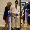 Student Council President Rob Austrian '13 and board member Tracy Merrill P '09, '11, '13 cut the ribbon at the dedication of the Barn Terrace.