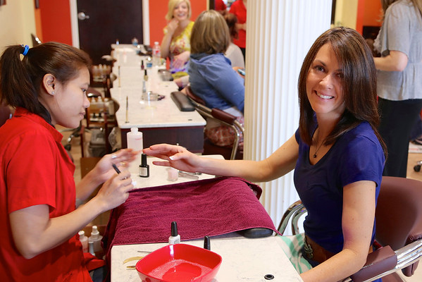 Prewedding activities for Rachel Lollar and Brad Spencer: mani-pedi day for the bridal party
