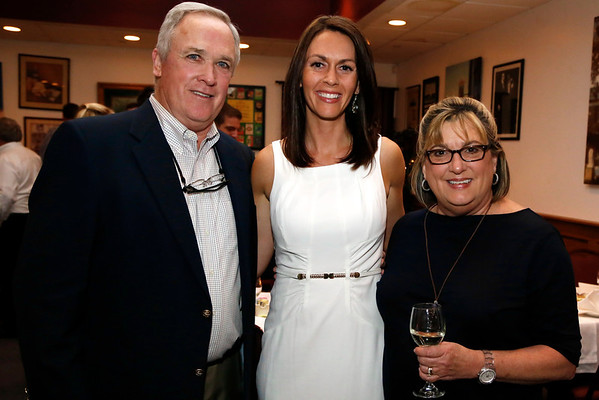 Prewedding activities for Rachel Lollar and Brad Spencer: The bride with Tony and Deb Lollar at the rehearsal dinner at Colletta's