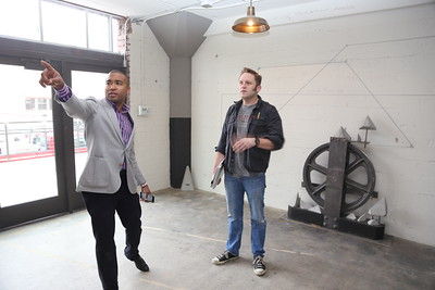 WAL Curator Tre Borden provides a tour to artist Casey Marshall.  (Photo by Joan Cusick)