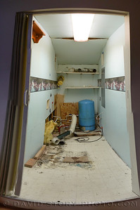 """The """"unedited"""" utility room minus washer and dryer."""