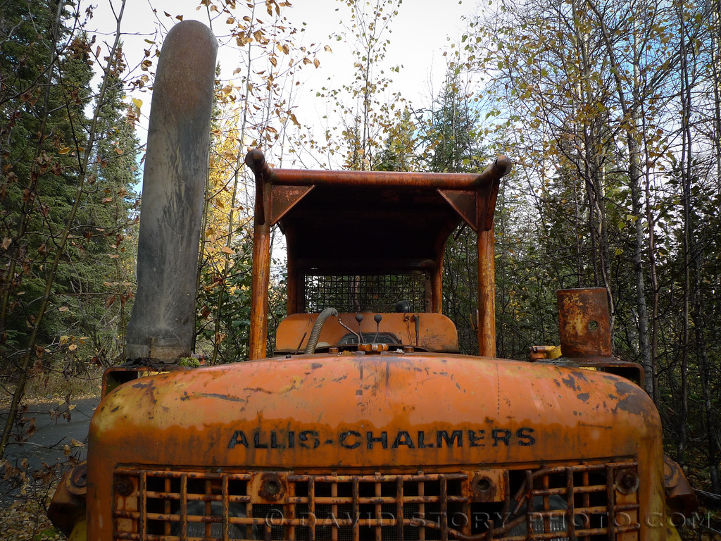A dozer sits idle along the Old Sterling Highway. Cooper Landing, AK