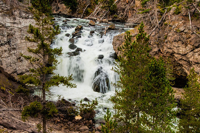 26 Feb 14.  Cold winning, so another short narrative. Recall that about a week ago I shared with you a photo of the initial drop of the Firehole River falls. Today I'm sharing the main body of the falls, and while it isn't an extremely long drop, in fact it is relatively short, probably less than 40 feet,  it is the placement of the rocks in the path of the water that makes this falls somewhat spectacular. Add to that the sound of the water crashing over the rocks and you have a first rate experience. There is a nearby parking lot but as it holds maybe 10 cars at most, you would want to visit this area before the crowds arrive. Otherwise it is a bit of a walk from the next nearest parking location. Other than a small amount of detail enhancement, this one is pretty much straight from the camera. Nikon D300s; 18 - 200; Aperture Priority;  ISO 200; 1/15 sec @ f / 29 on a tripod. Shutter and aperture combination selected to smooth the water.