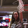 JR Payne Head Coach for the Southern Utah Women's Basketball team holds up the net after beating out Northern Colorado in the Big Sky Championship on Saturday March 8, 2014.