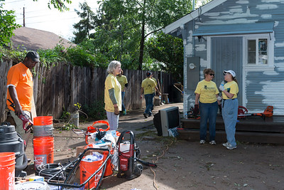 Volunteers work on the Butler home in South Sacramento during Rebuild Day on April 25, 2015. (Photo by Leilani Paular)