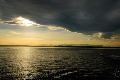 09 Dec 15.  While weather patterns featuring story conditions are not all that unusual around here, being out in one with a ceiling of less than 100 feet isn't all that common, in fact, it is rather rare. On this particular afternoon we were crossing Puget Sound when we encountered a rather unusual storm which was rapidly blocking out the sun and presenting us with some very interesting looking clouds. We were traveling faster than the storm so we got to see it approach, pass under it, and then see it leave. From what I could tell we were doing most of the moving and as you can see from the sea state there wasn't a lot of wind associated with the storm. With a ceiling like this, it would definitely be a no fly day.  The base image was adjusted for max tonality, given some micro contrast adjustment, and that was it.  Nikon D300s; 18 - 200; Aperture priority; ISO 200; 1/640 sec @ f /13.