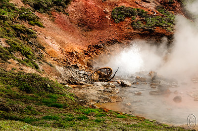 09 Nov 15.   Of all the places in Yellowstone we visit, Artist's Paintpots is Jan's favorite, mostly for the two bubbling mud pools at the top of the site. The climb up is relatively easy and there are two approaches but either way it is the same trail. Starting at the bottom you are greeted by several small pools of bubbling liquid something along with a couple of obvious tiny geysers. This one sits at the very corner of the left hand side of the loop trail and is constantly splashing water although not always to the same height. As such, with the right wind, it can catch you off guard and leave you a bit damp. The trail is at the bottom of the image and travels clockwise up the side of the bank for perhaps 60 feet in height but on a gentle slope. From the top the view down looking at the paint pots as well as out across the valley, to say nothing about the mud pots, is well worth the easy climb. The only drawback is that it is frequently not open when we visit in the spring but if you go anytime after the end of May you will find it accessible. Be sure to put it on Yellowstone bucket list!  The base image was adjusted for max tonality and then give a tiny amount of micro contrast enhancement. Nikon D300s; 18 - 200; Aperture Priority;  ISO 200; 1/640 sec @ f / 8.