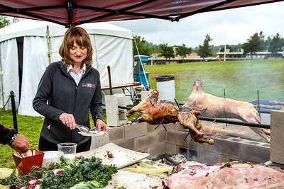 Tracy Berkner of Taste Restaurant serves lamb at the Amador Four Fires Festival