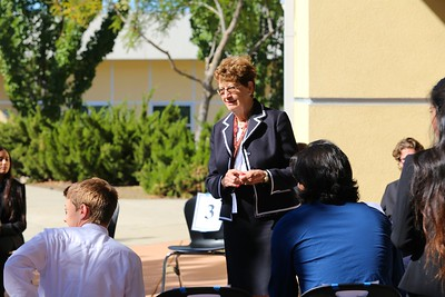 Outside the Whitney High School library, Dr. Carol Ann Hackley talks with students waiting for their interviews.