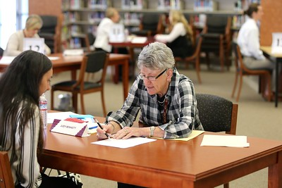 Interviewer Judy Bennett reviews the resume and cover letter with a Whitney student.