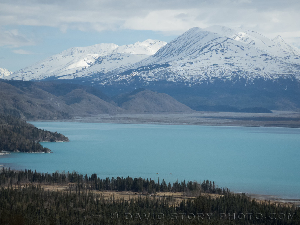 2017 05 10: Dwarfed by the size of the surrounding wilderness, rafts cross the glacial waters of Skilak Lake, AK.