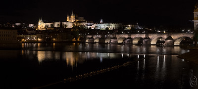 15 Nov 17	 I thought I'd share with you my all time favorite shot of the trip. It was my desire to capture something along these lines our third evening in Praha that led to the loss of the phone. Had that not happened, and my subsequent over present concern about it, I'm rather certain I would have gone out another night to shoot again but I didn't. In retrospect that was a foolish decision. Still, I got several shots of Charles Bridge, Charles IV being the favorite king of all things Czech after whom the bridge is named, many of which I really like. But a few more would have been O.K. The bridge is one of, I believe, 9 major bridges that cross the Vltava (Moldau) River in Praha, but the locals claim there are more than 100. This shot shows a corner of the Old Town Tower (there are two more on the opposite end of the bridge near Prague Castle) as well as a small portion of a group of wooden beams projecting into the river whose function I have no idea. In the middle of the photo is located a very small spillway that crosses the river but doesn't serve any function I could discern. There is a log boom of perhaps 40 perpendicular to it whose main function appeared to be a roosting site for many seagulls, of which quite a few are visible in the image. About 1/3 of the way into the image from the left you can see Prague Castle which might remind some of you of the castle design used by the Disney Corporation. I've attached a link above in blue discussing the bridge which I recommend you read. I'll share a couple more shots of the bridge at another time.  Aside from cropping of a fair amount of empty space on the top and bottom of the frame, this is straight from the camera.  Nikon D500; 18 - 200; Aperture Priority;  ISO 1000; 1/2 sec @ f / 9 on a tripod.