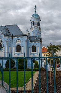 04 Apr 18	One of if not the biggest tourist sights in Bratislava is the Church of St. Elizabeth otherwise known as the Blue Church. It is really a very lovely building and would be worth seeing even if not a tourist attraction. It is an active church and based on all the handbills I saw tacked on one of the  main doors I'm assuming very involved in local affairs. It was a very busy afternoon when I was visiting which means the opportunity of finding a suitable location for taking a photo was non existent but I did the best I could and took lots of images in hopes that I would get something usable. The shot for today shows only a portion of the building and even so not as well as I'd like, but it should give you a rough idea of what the building looks like. I'll share some more of it but thought that I should give you a general idea of how it looks before I share just portions of the construction. The link has a nice photo apparently taken from a position of height as you can't get the perspective on the ground.  I've cropped and straightened the original some plus given it a small amount of contrast enhancement. Nikon D500; 18 - 200; Aperture Priority; ISO 1000; 1/2000 sec @ f / 8.