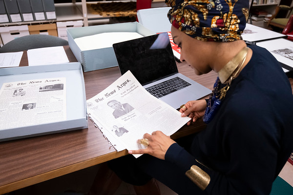 """20190212 Incarceration Research Archives Video   Approximately 20 students working in the O'Kelly Library archives to research the Winston-Salem chapter of the Black Panther Party for our States of Incarceration project that asks, """"Who is a political prisoner?"""" Dr. Siddiqui, along with Tom Flynn, will be assisting these students.  Ty'Quarious Cheek (Junior, Political Science Major. Black colleges sweatshirt   Taylor Blakeney (Freshman, psychology major). Black sweatshirt"""