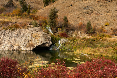 15 April 19	This week we'll finish off the remaining fall Yellowstone images. Next week - 22 to 26 - I'll be away dog sitting and likely may not be able to send. The 30th I leave for Yellowstone returning on the 8th of May so this week's images will quite possibly be the last I send until the 2nd full week of May. During that lapse feel encouraged to visit the blog archives and enjoy the photos you want for each day.  Today's submission is just another of the views that was with me mile after mile driving west along highway I-90. On this particular day, perhaps in part due to the weather, traffic was very light and I was able to stop pretty much at will and not really be bothered by the passing vehicles. I enjoy that kind of a day when I'm traveling as my less than break neck speed doesn't really hinder the traffic at all and I have lots of freedom to stop. I get to see this little tiny fall on every trip and each time it is different and each time a delight. All it's missing is a jumping trout!  I've cropped the original a bit and done a little dodging and burning but that's it. Watering Stop  Nikon D500; 18 - 200; Aperture priority; ISO 200; 1/125 sec @ f /11.