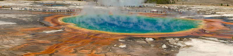 """22 Oct 19Back to Yellowstone, yee haw as some may say. The determining factor as to whether this fall trip to Yellowstone would be a success or not was my being able to finally get the photo of Grand Prismatic Spring from above that I've been trying to get for 4 years. One of my neighbors, who is a park ranger, had promised to take me there this time around but when I approached her she begged off saying her mother was rather ill and she didn't have time. But she gave me directions which really didn't help. We tried to find it but failed on our first day in the park. But I did some more questioning of folks and finally got enough info that I thought we might find it. When I did, in the company of a friend visiting from MD, it was exactly how I was told to find it but that realization came after making the trip, not before. From the Fairy Falls parking lot one takes the trail to Fairy Falls from the Iron Bridge at the edge of the parking area and you walk perhaps one half mile on a wheel chair accessible trail where the trail makes a """"Y""""; you take the left leg of the """"Y"""" and walk perhaps another two blocks with an elevation rise of maybe 100 feet. This trail is also wheel chair capable but the pusher may find the climb a little strenuous.  Once you get there you have a full view of the Spring which may or may not be a disappointment; it was a disappointment for me because the pictures I had been seeing were taken from an overhead - aerial - perspective and from the observation point you don't quite get that. On top of that an attempt to get such a shot is now prohibited. One can only gue$$ how that came about! But I did get my shot, such as you can, and that's what I'm sharing today; thus the trip was a success. The view from the observation deck is certainly different from that which you get standing in the """"fog"""" poolside but both vantage points are necessary for a full appreciation of Grand Prismatic Spring. One thing I got from the observation deck view is that it"""