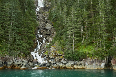 Getting up close to a waterfall in Aialik Bay, Kenai Fjords National Park.