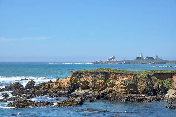 """View of Piedras Blancas - """"white rocks"""" - and the lighthouse"""