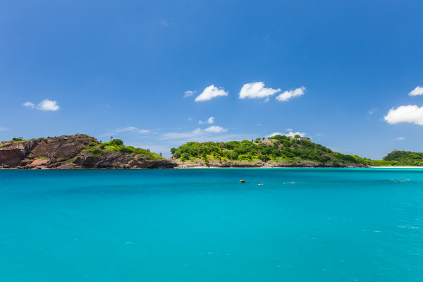 A mast and the outline of the Andes in the middle of Deep Bay, Antigua.  Fort Barrington sits on the hill above