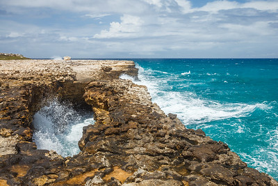 The Devil's Bridge, Antigua.  Legend says that escaped slaves would commit mass suicides by jumping into the churning water.