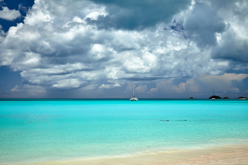 Locals floating in the water at Jolly Beach, Antigua