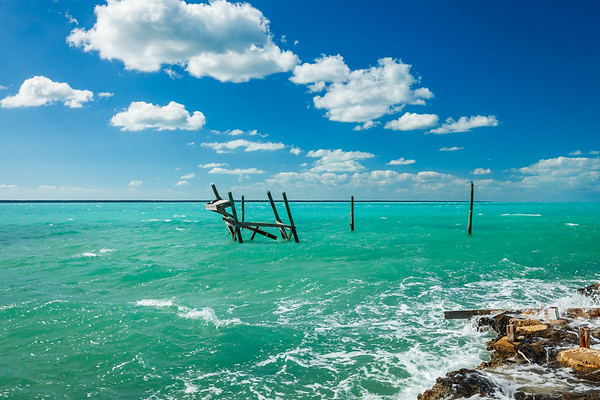 An old hurricane-damaged pier in New Plymouth, Green Turtle Cay, Bahamas