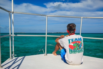 Lambert, one of the dive instructors at Froggies, sitting topside on the way to Fowl Cay