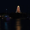 The Elbow Cay Lighthouse Christmas lights reflecting in Hope Town Harbor