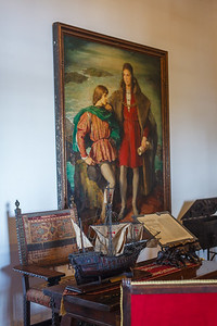 Painting of Christopher Colombus and his son Diego, with a model of the Santa Maria in the foreground, at the Alcazar de Colon.  Santo Domingo.