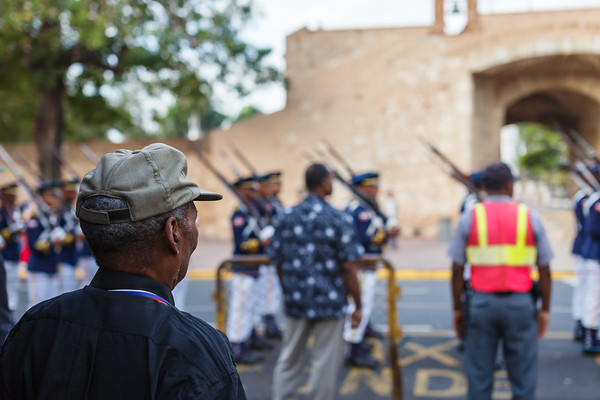 A veteran of the Dominican military watches the parade during Indpendence Day