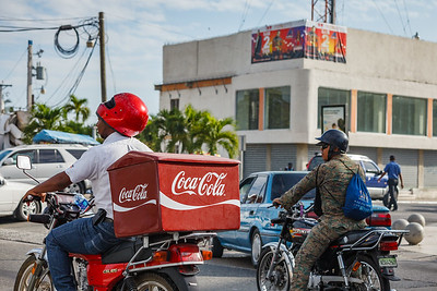 Many Dominicans use motos for transportation.  It's a free-for-all when it comes to driving, and having a highly-maneuverable vehicle seems somewhat safer despite the inherent danger of motorcycles.