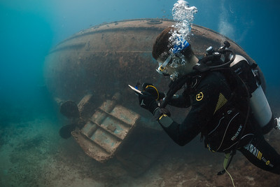 Federico, an Italian student in the Wreck Diver specialty, surveys and sketches the Catuan wreck